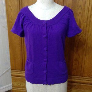 Purple short sleeved sweater.